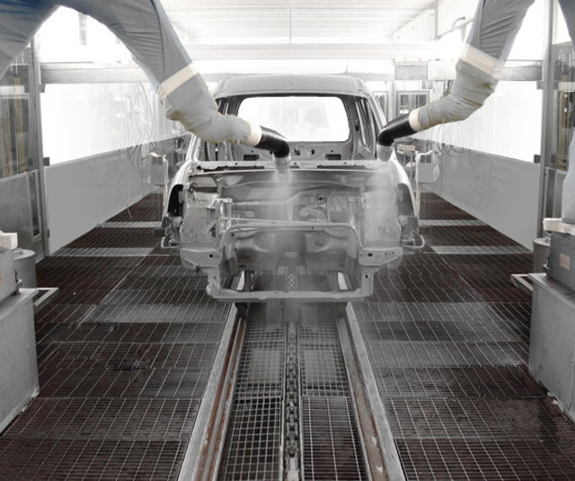 Carbody finishing with robotic bell